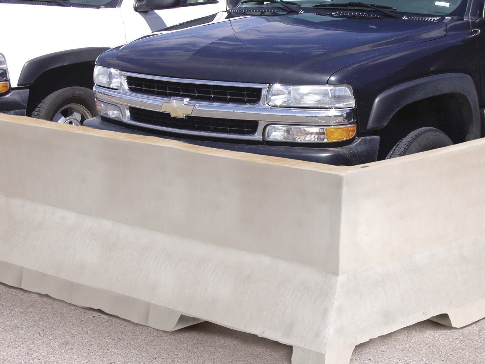 Precast Concrete Traffic Barrier In Parking Lot